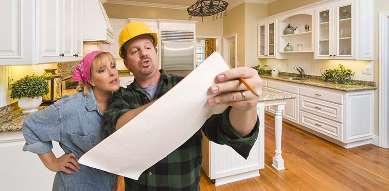 Professional Home Remodeler Discussing Plans with Customer