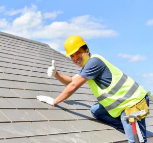 Builder Working on Roof—Morocho's Home Improvement Inc.