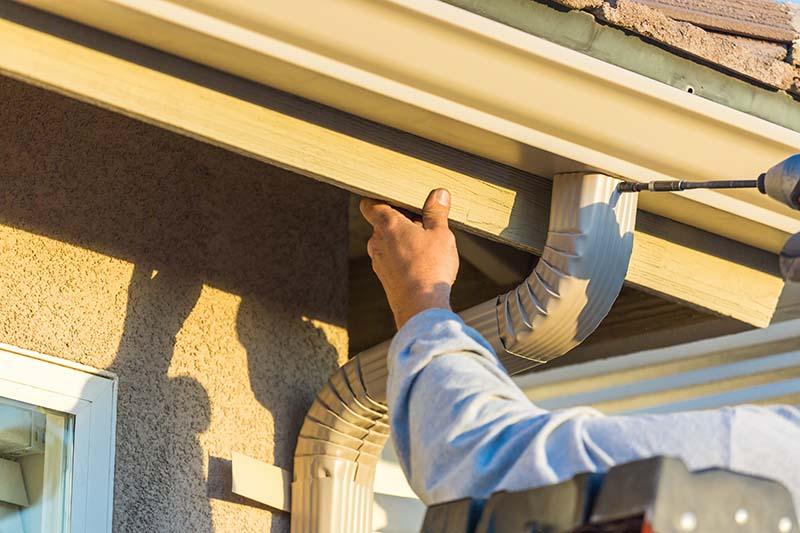 Worker Doing Aluminum Gutter Installation in White Plains NY